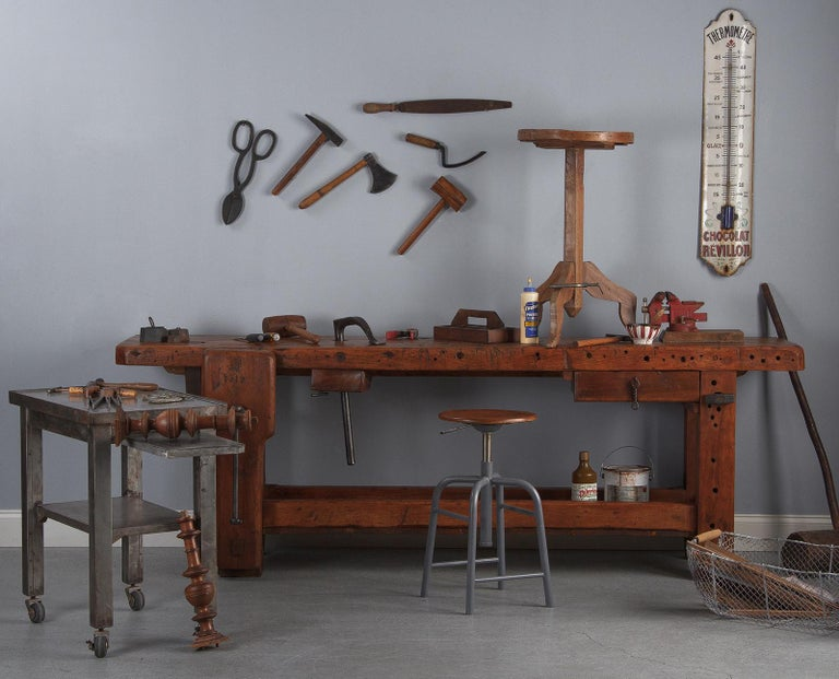 A large beechwood carpenter's etabli workbench, French, 1919. Made and marked by J.G. in 1919, the workbench shows signs of decades of hard use, just as you'd want on such a piece. It has a beautiful, warm surface with lots of cuts and pitting, as