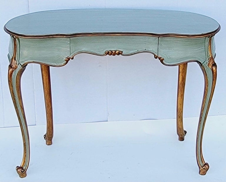 This is a lovely French carved and painted giltwood desk that could also work as a vanity or side table. It is a lovely seafoam color, and the piece does have dovetail construction.