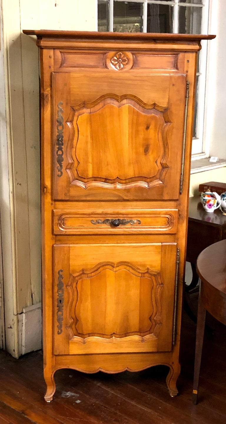 Wonderfully sized Antique French carved cherry Louis XV style Bonnetiere. These useful pieces became fashionable at the late 18th century when women of prominence began wearing large and impressive hats or bonnets. They were used for storing these