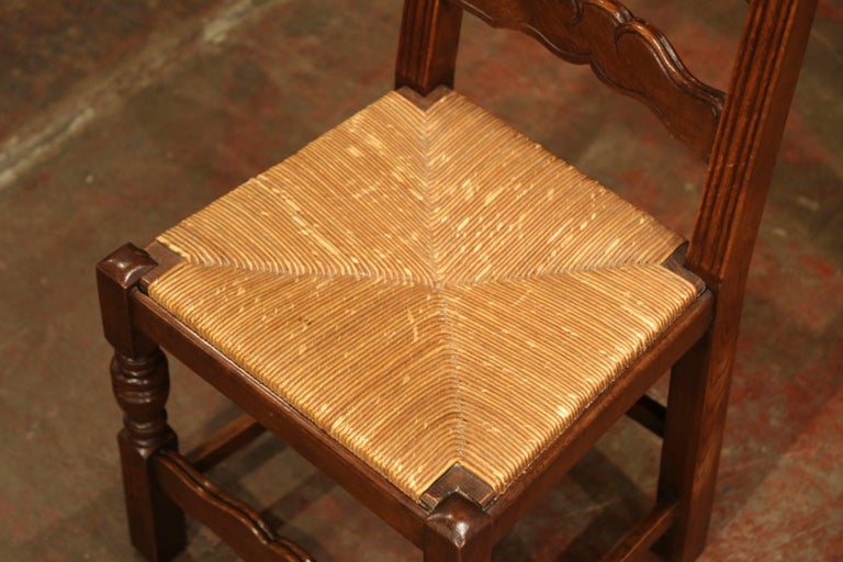 Late 20th Century French Carved Oak Ladder Back Chairs with Rush Woven Seat, Set of Six For Sale