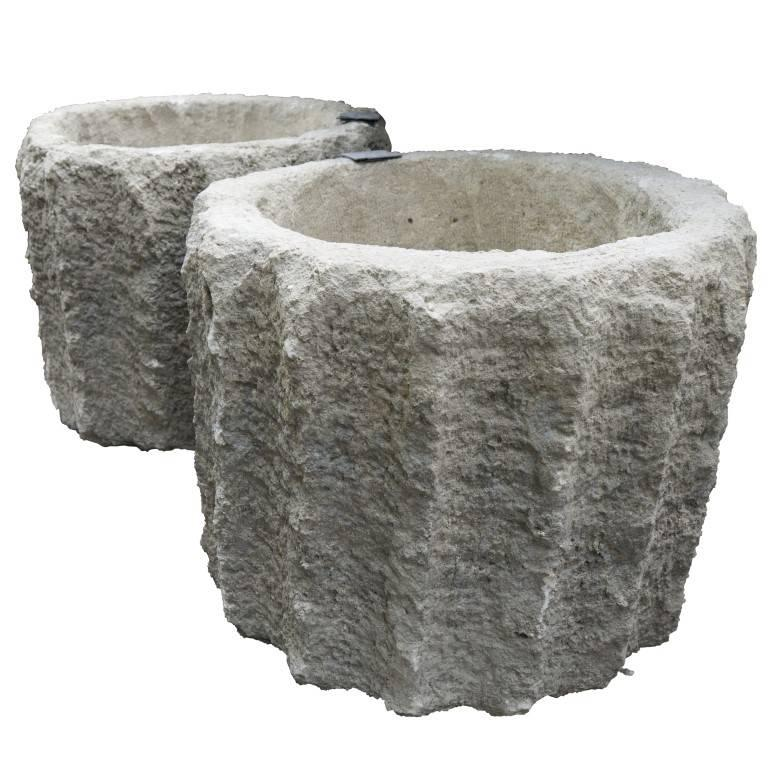 These carved stone planters have a ribbed design resembling a gear and are an incredibly beautiful addition to any landscape design.