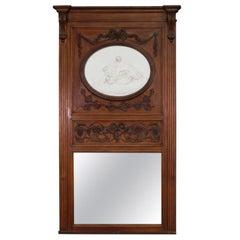 French Carved Walnut Tall Trumeau Mirror with Plaster Cherub Plaque, circa 1860s
