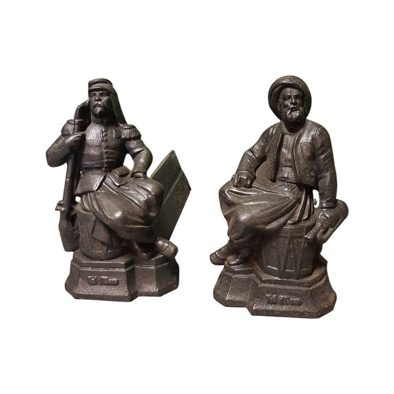 French Cast Iron Andirons with Persons Sitting on a Drum, Early 20th Century For Sale