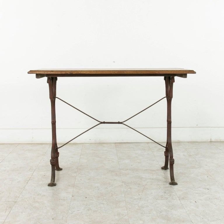 French Cast Iron Bistro Table or Cafe Table with Oak Top, circa 1900 In Good Condition For Sale In Fayetteville, AR