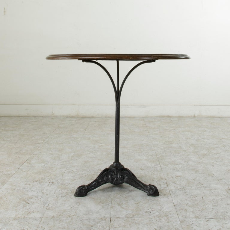 French Cast Iron Bistro Table or Cafe Table with Round Walnut Top, circa 1900 In Good Condition For Sale In Fayetteville, AR