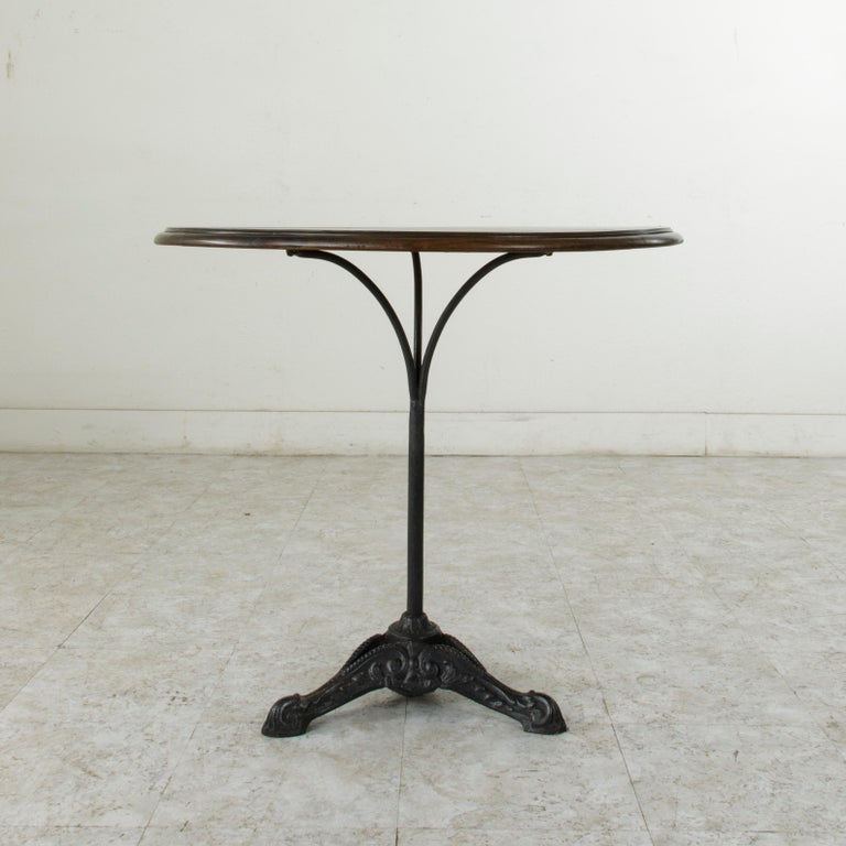Early 20th Century French Cast Iron Bistro Table or Cafe Table with Round Walnut Top, circa 1900 For Sale