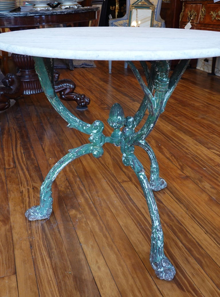 19th Century French Cast Iron Garden Table with Marble Top and Decorative Tripod Base For Sale