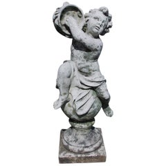 French Cast Stone Musical Putti Garden Ornament Seated on Sphere Plinth, C. 1840