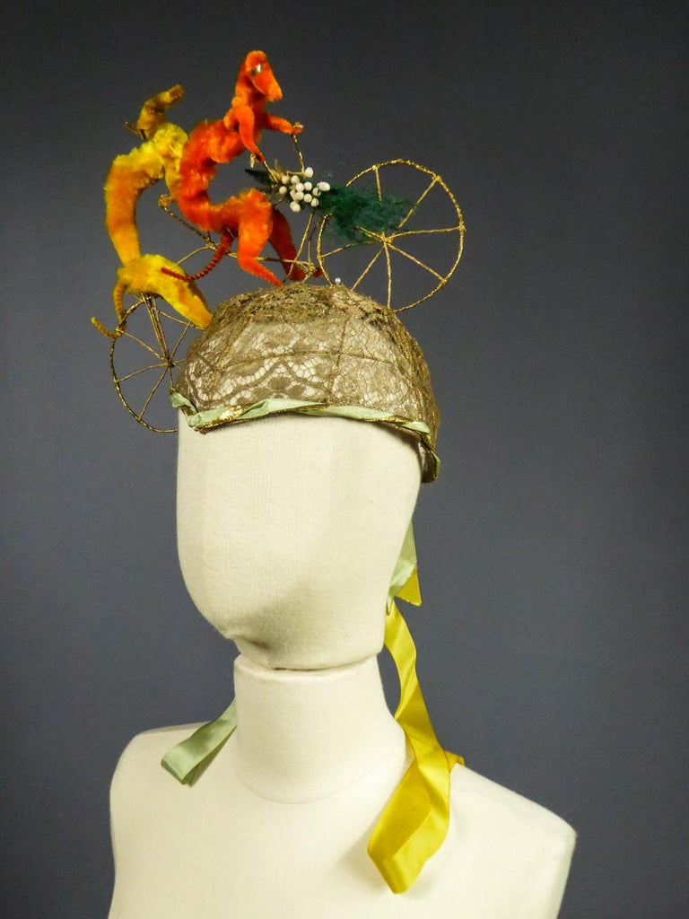 Circa 1920/1930 France  Moving bell-shaped Catherinette headdress surmounted by an astonishing tandem bicycle of plush greyhounds, probably from a Parisian fashion designer house between the two 20th century Worldwars. Elaborate work of a