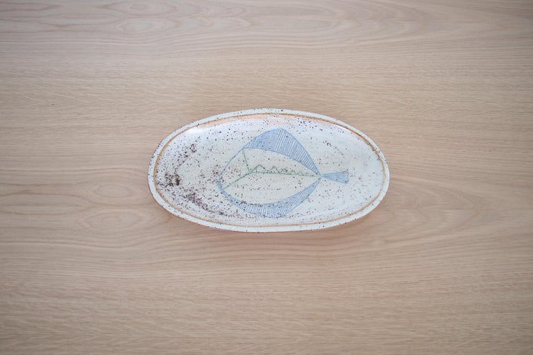 French ceramic dish with hand painted fish motif. Beautiful cream, blue, and brown coloring. Great as a platter or catch-all.