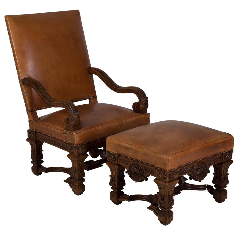 A 19th century French chair and ottoman. Very well carved with later leather upholstery. Seat height 50cm, seat depth 53.5cm.