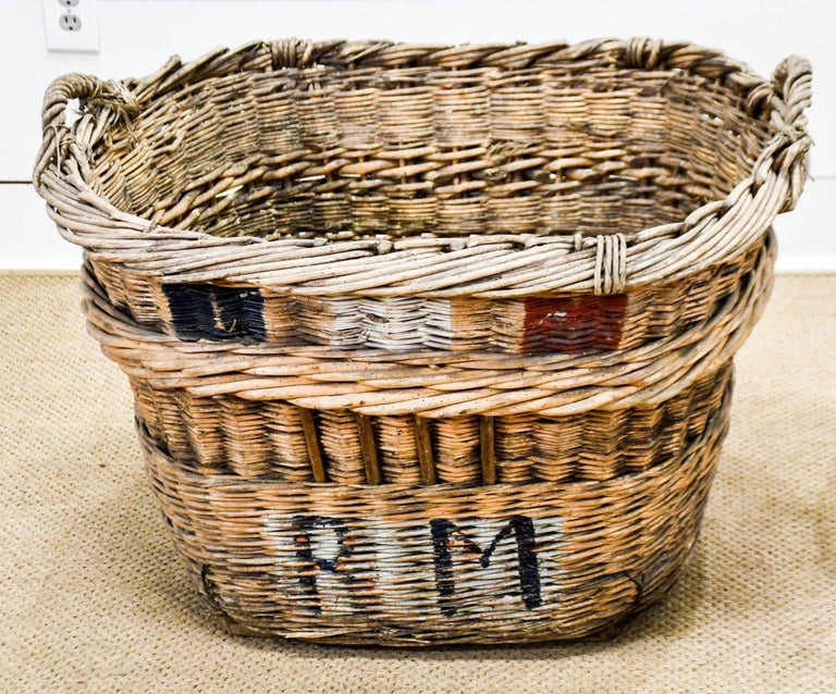 Wonderful large champagne grape gathering baskets can be used for a multiple of purposes -- laundry, toys, firewood, or just plain old decoration.