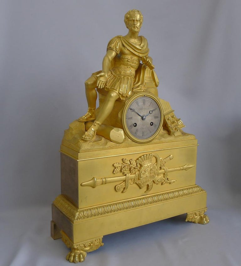 An extremely rare antique French Charles X period ormolu musical mantel clock of Gaius Marius amidst the ruins of Carthage by the noted maker Jean Eugène Robert-Houdin. The superb and entirely original ormolu, showing Gaius Marius sitting in the