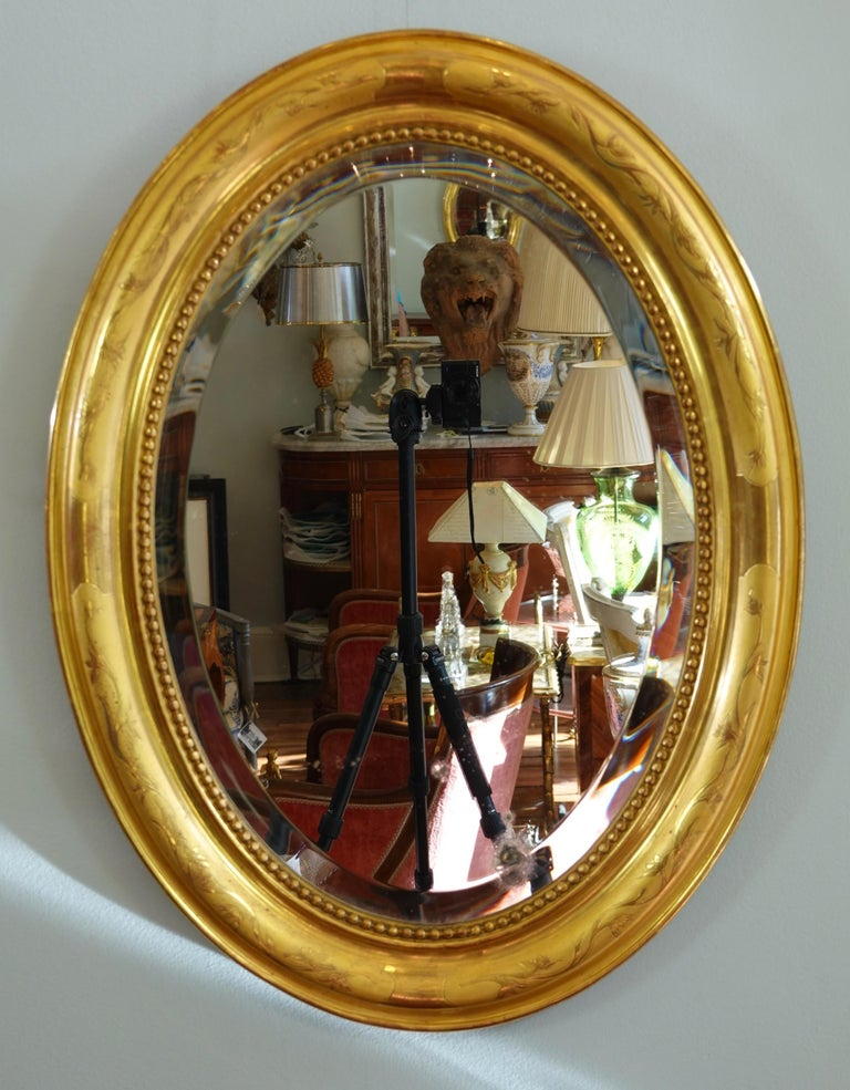 Gilt French Charles X Oval Mirror with Beveled Glass For Sale