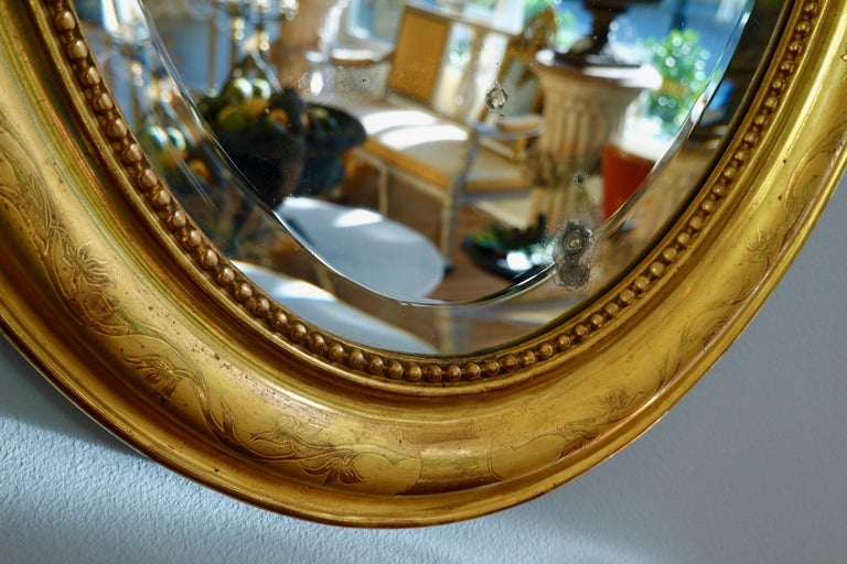 19th Century French Charles X Oval Mirror with Beveled Glass For Sale