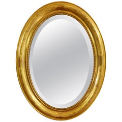 French Charles X Oval Mirror with Beveled Glass