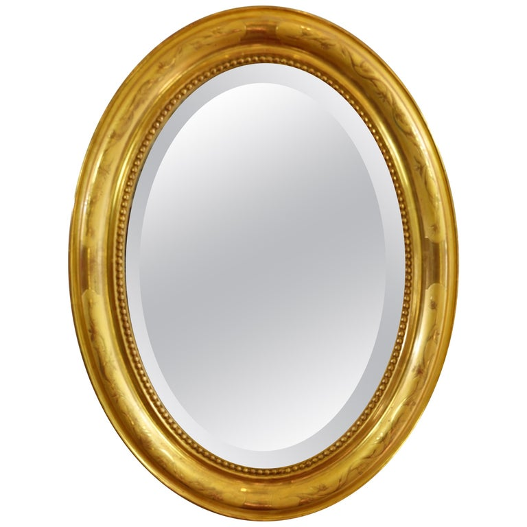 French Charles X Oval Mirror with Beveled Glass For Sale