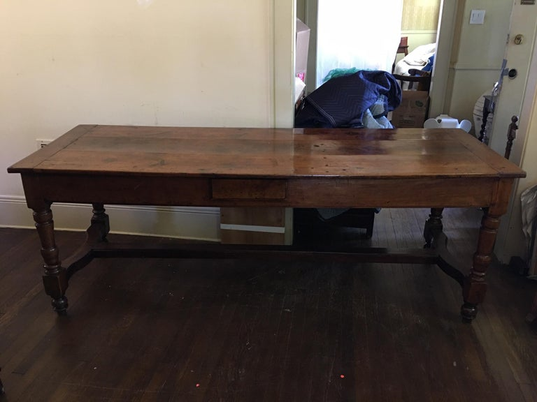 French cherry work table with drawers, yoke stretchers, and pull out servers on each end, circa 1830.