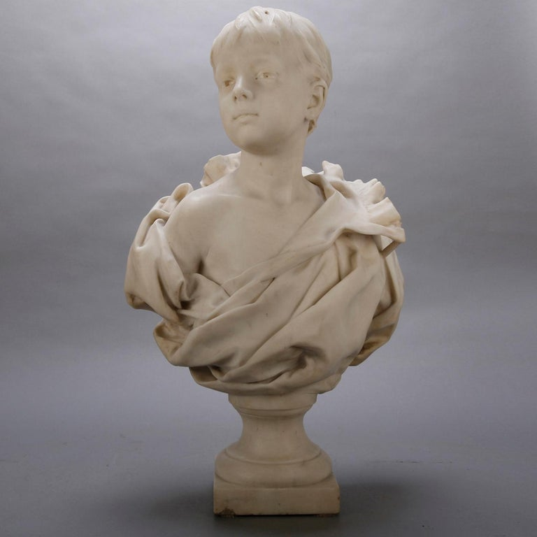 An antique French classical marble sculpture depicts highly detailed bust portrait of young boy, signed H Nelson (French 1854-1919), circa 1880  ***DELIVERY NOTICE – Due to COVID-19 we are employing NO-CONTACT PRACTICES in the transfer of purchased