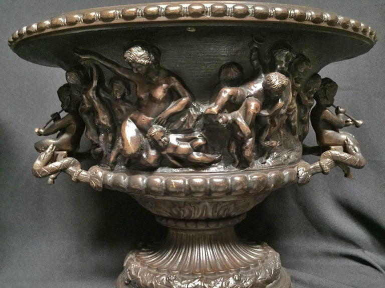 19th century impressive large French Clodion style oval centerpiece with cherub handles. The gadrooned edge over a detailed frieze of frolicking putti with grapes and musical instruments. The finely cast pedestal base is in great proportion to the