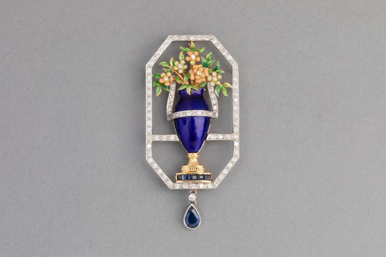 Very lovely Brooch, made in France circa 1950.   Made in Yellow and white gold 750. French mark: Eagle, signature of the maker (unknown).  The design represent flower on a vase.  The vase and the flowers are covered with bleu enamel in perfect