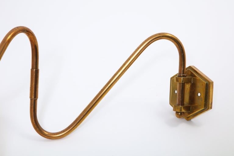 French swing arm sconce in copper. Interesting design and original patina.  Original shade. Rewiring and backplate on request.