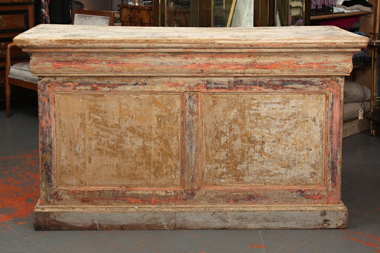 Very functional store counter from France. Layers of paint have been stripped away, many drawers. Would make a great kitchen island or console as well as a perfect check-out counter for a retail setting