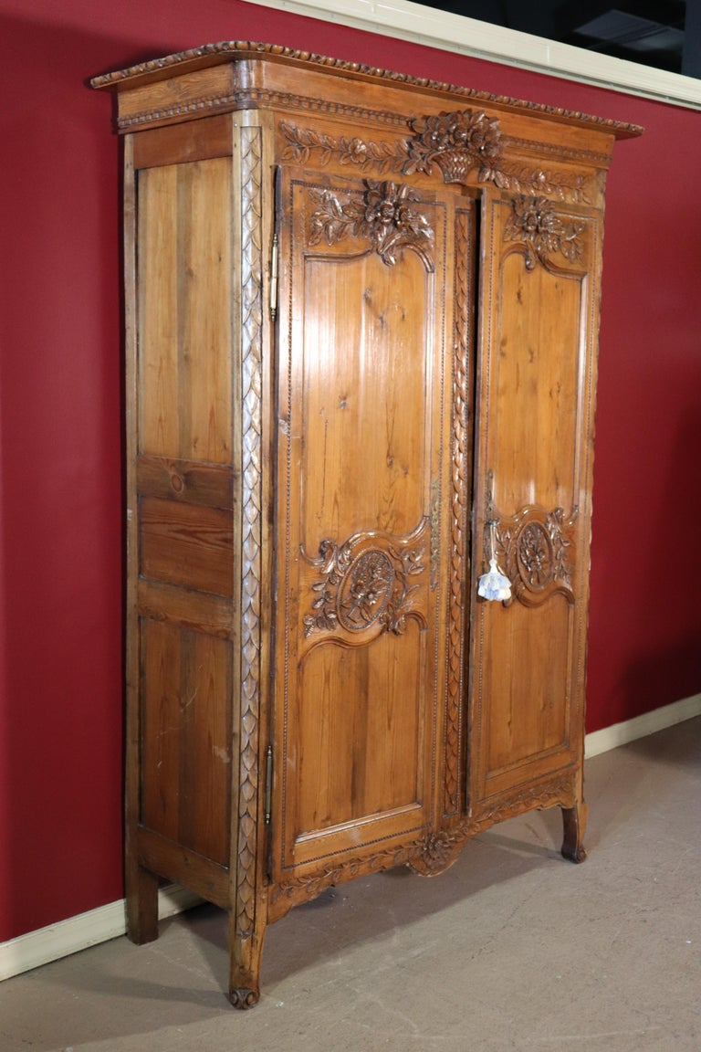 Louis XV French Country Carved Pine Wedding Armoire Wardrobe with Basket of Flowers For Sale