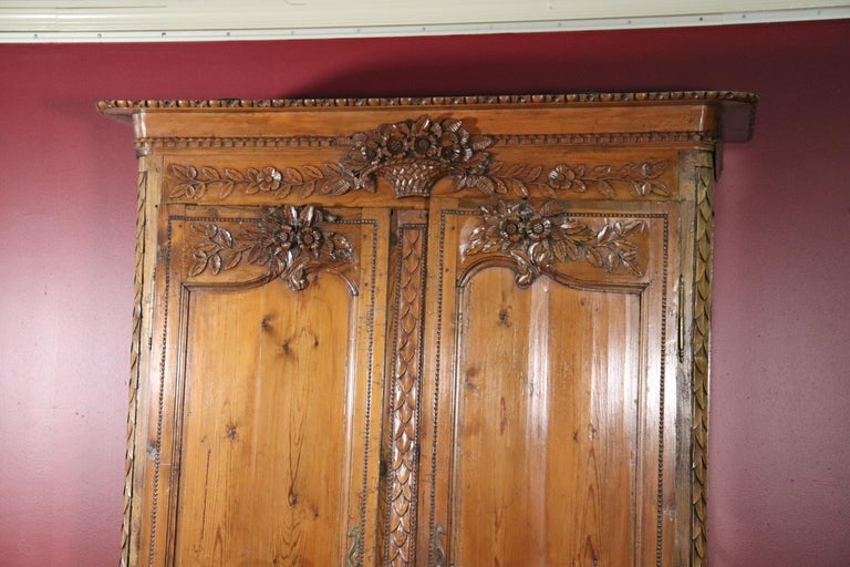 French Country Carved Pine Wedding Armoire Wardrobe with Basket of Flowers In Good Condition For Sale In Swedesboro, NJ