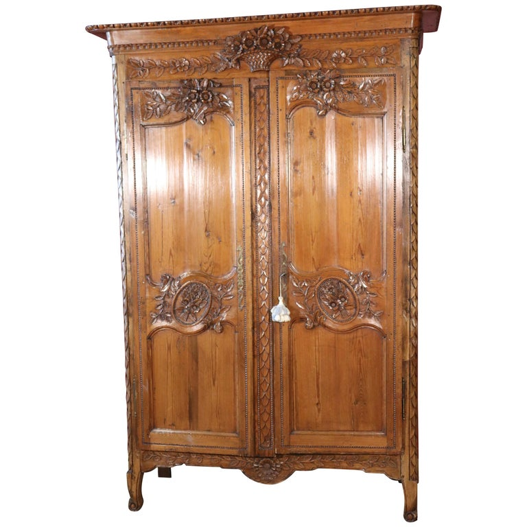 French Country Carved Pine Wedding Armoire Wardrobe with Basket of Flowers For Sale
