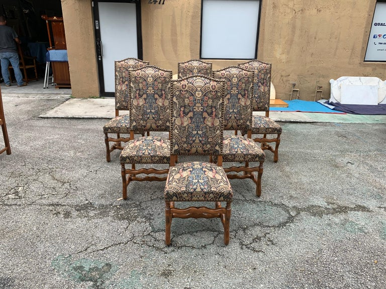 Fine set of six Louis XIII style Os de Mouton dining chairs with chapeau de gendarme backs, circa 1900th century. Vintage fabric upholstery with nail-heads, solid walnut chair frames are in excellent condition. From South France Bordeaux. (The