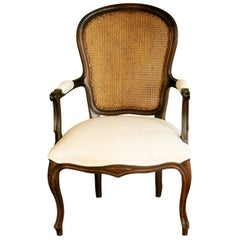 French Louis XVI Style Armchair Carved Walnut with Caned Backrest