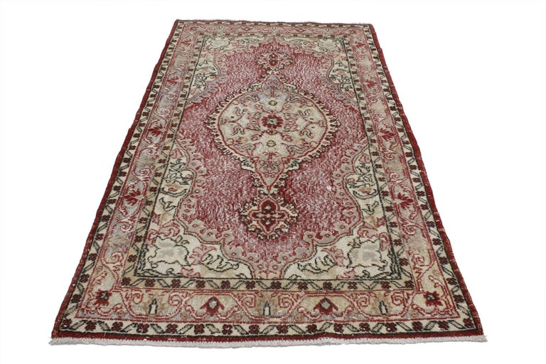 51941, French country style distressed vintage Turkish Sivas rug, Accent rug. Dashing and darling this distressed vintage Sivas rug embodies the beauty of French Country style and Turkish weaving. A round medallion with pendants at opposite ends