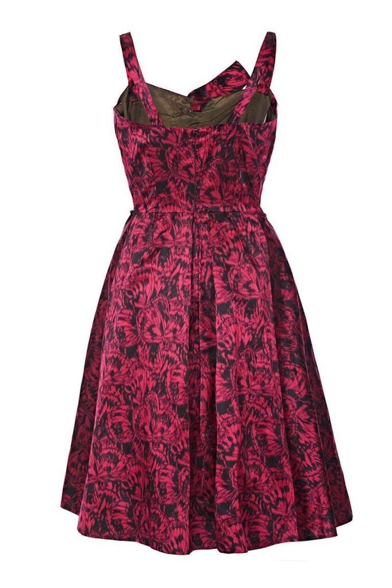 This opulent 1950s French couture silk satin evening dress by Perrine has exquisite construction and is of superb quality. The luxurious deep red satin overlay has an unusual butterfly wing print and is beautifully tailored to ensure drama and
