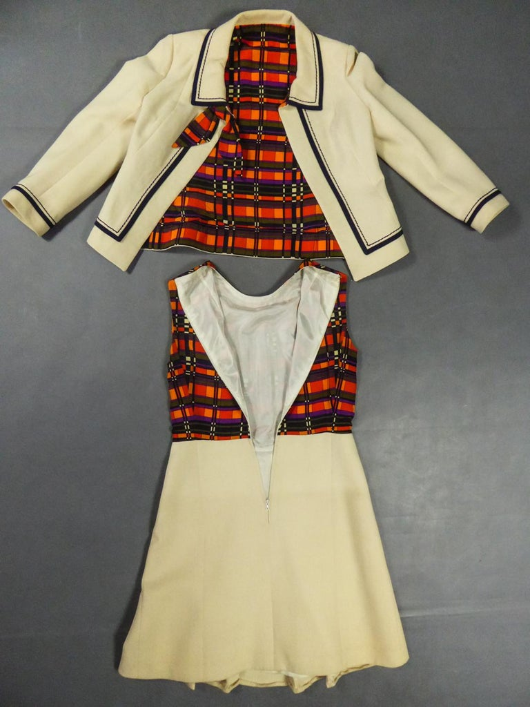 Circa 1972 France  Dress and jacket in wool and silk, anonymous Haute Couture without label around 1972. Straight dress with cream nylon lining and zip fastening at the back. Sleeveless top and crew-neck in checked silk taffeta. Elegant work of