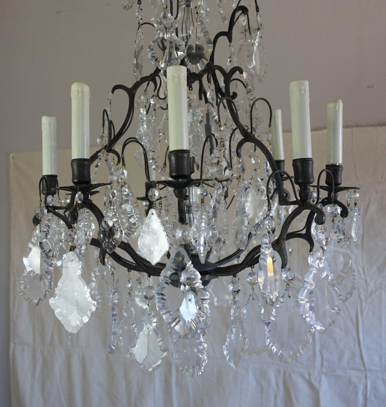 French crystal (nine) light chandelier with an antique finished brass frame adorned with quality pendeloque shaped crystals throughout. Great scale for a bedroom, dining room or entry. The fixture is wired with American sockets and is ready to