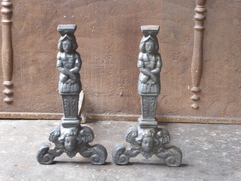 20th century French D'Artagnan firedogs made of cast iron. D'Artagnan is the best known hero of the three Musketeers.