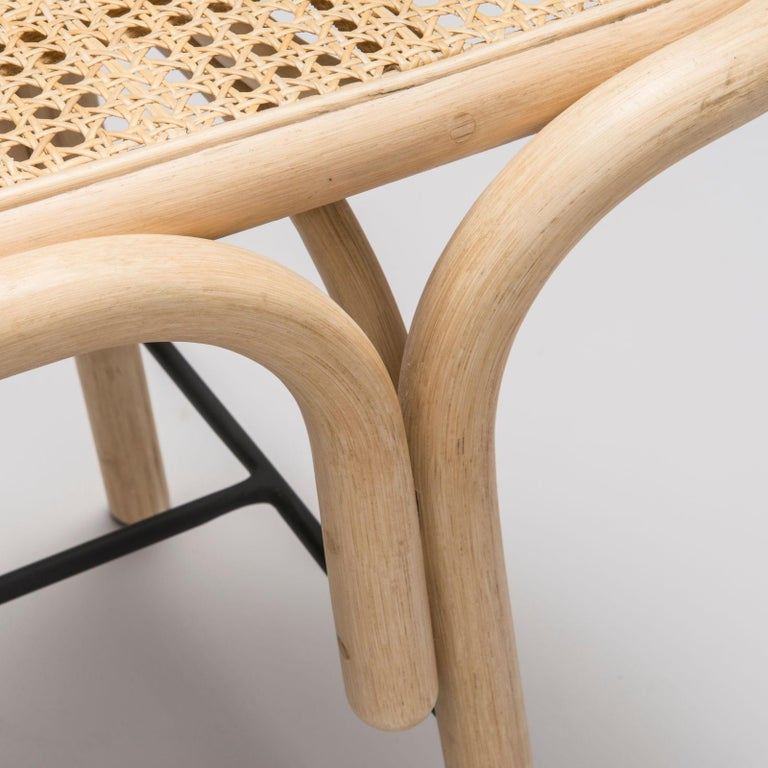 French design bench in black metal and rattan structure with cane seat.
