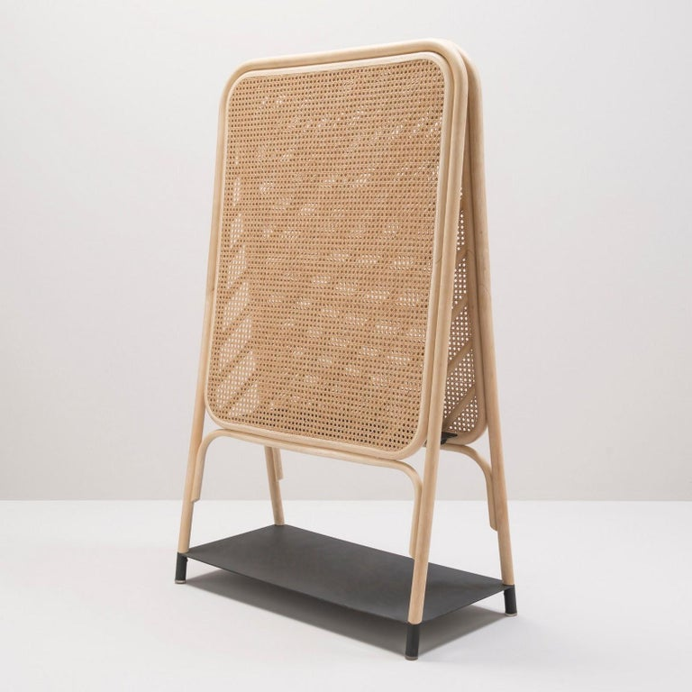 Magnificent screen, French design and work of a great fineness in natural rattan, wicker cane and metal. Perfect for room separation, it will also take place in your entrance due to the low and middle black metal storage shelves where you can put