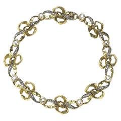 French Diamond and Gold Bow Bracelet, circa 1950