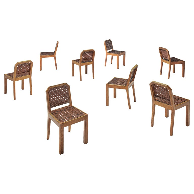 French Set of Eight Dining Chairs in Oak and Woven Leather For Sale