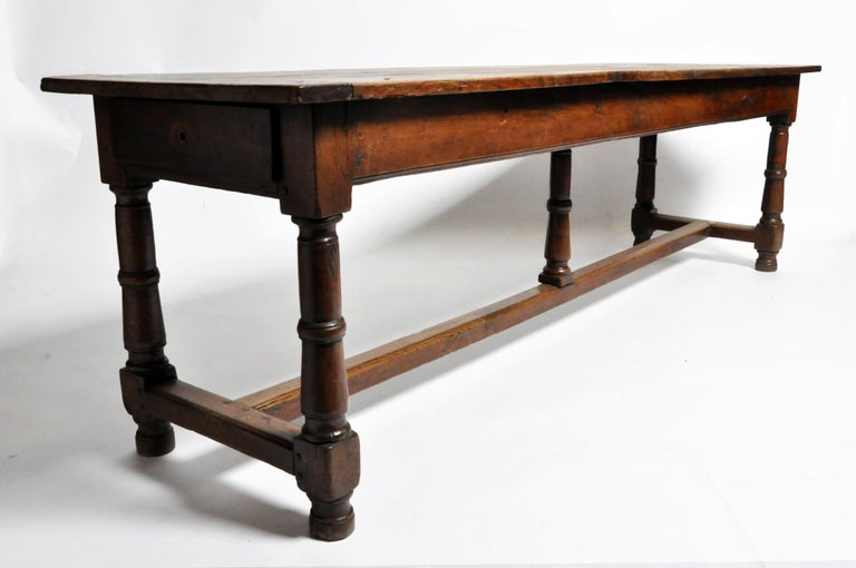 This impressive draper's table is from France and dates to the 19th century and is made from solid oak. The table features two drawers and a beautiful aged patina. The sides and legs retain some of their original darker finish and some antique