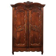 French Early 19th Century Cherry Armoire from Rennes Brittany with Carved Motifs