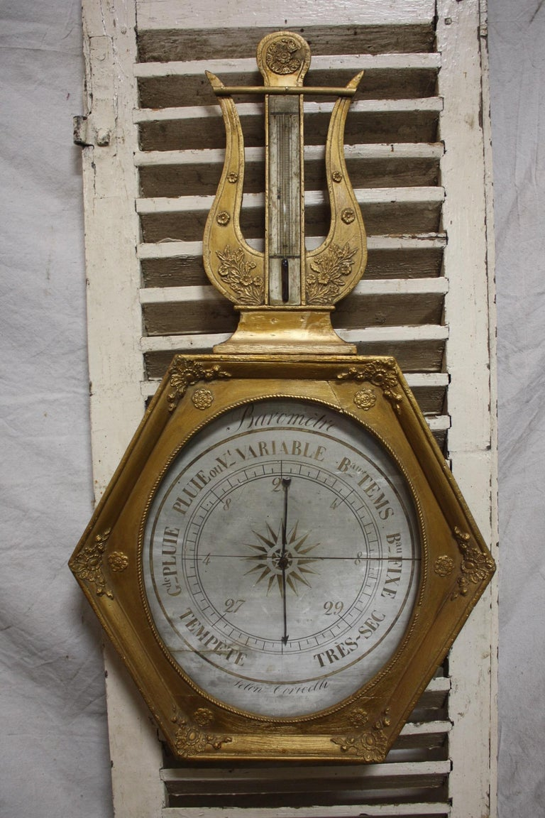 French early 19th century gilt barometer.