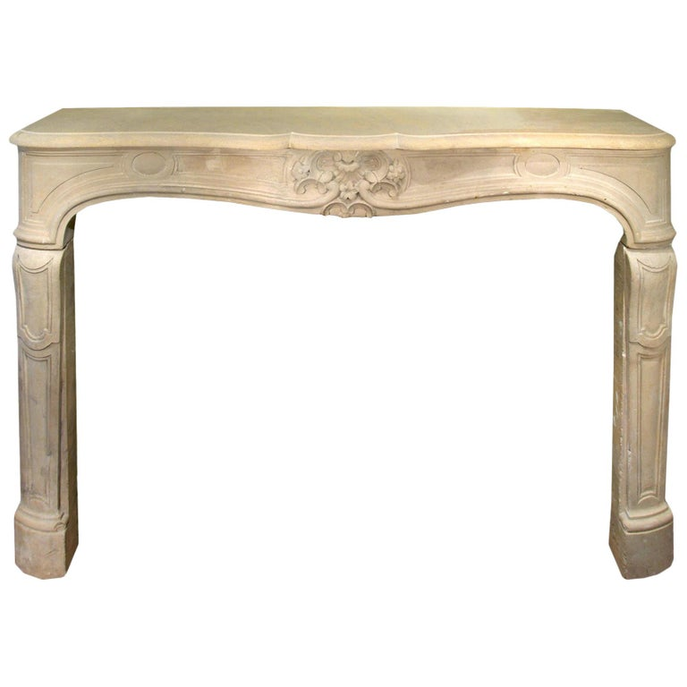 French Early 19th Century Louis XV Style Limestone Fireplace Mantel For Sale
