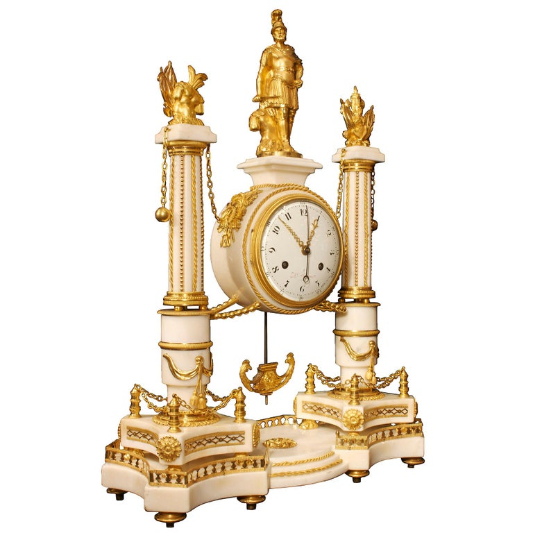 A spectacular and extremely high quality French early 19th century Louis XVI st. white Carrara marble and mercury gilt ormolu clock, signed Simona à Paris, circa 1819. This very powerful clock with military symbolism is decorated by finely chased