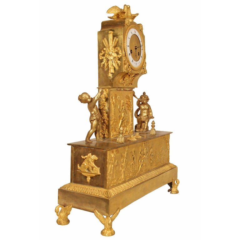 A spectacular and unique French early 19th century Louis XVI St. ormolu mantel clock, signed by Chapsal a Paris. The clock is raised on finely chased swan supports below a rectangular base. The façade has a finely chased plaque of a landscape scene