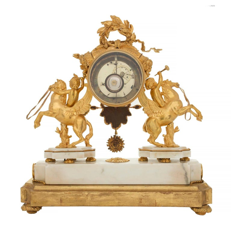 French Early 19th Century Louis XVI Style Ormolu, Marble and Giltwood Clock In Excellent Condition For Sale In West Palm Beach, FL