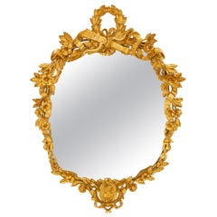 French Early 19th Century Louis XVI Style Oval Giltwood Mirror