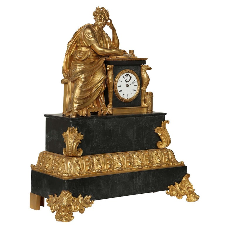 A stunning French early 19th century Neo-Classical st. ormolu and black marble clock, stamped ARERA, circa 1830. The clock is raised on finely chased ormolu supports of scrolls ending with animal faces. The black marble base is decorated with ormolu